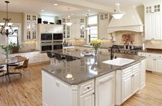 Traditional Kitchen with Custom hood, Casement, dishwasher, Standard height, Pendant light, Simple granite counters, Paint 2