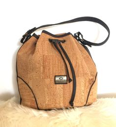 This wonderful shoulder cork bag, handbag is made from cork and leather. Perfectly finished, High Quality, durable and waterproof. This bag can be a great gift.      Features:    - Made from Cork-Eco-friendly material    - Soft and durable    - One color        External size    25 x 25 x 13cm      How to clean cork?    - Cork is stain and water resistant.    - Cork is very easy to maintain as new, just need to clean with a dump soft cloth.      *Colours may differ slightly from the original…