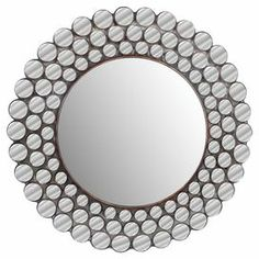 "Metal wall mirror with a mosaic-inspired frame.  Product: Wall mirrorConstruction Material: Metal and mirrored glassColor: SilverDimensions: 30"" Diameter"