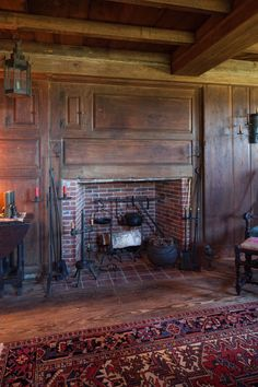 This masterpiece restoration of a 1665 Pilgrim era saltbox garrison style home, along with its ancillary structures, artfully blends pristine historic architecture with modern conveniences. Primitive Fireplace, Cozy Fireplace, Fireplace Surrounds, Fireplace Mantels, Primitive Homes, Mantles, New England Homes, Mid Century House, 18th Century