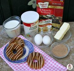 Cinnamon-Roll-Doughnuts -- The Doughnuts start w/ cake mix, adding eggs, milk and butter so the batter is smooth and creamy. Then add the Frosting Creations Cinnamon Roll flavor packet for a burst of cinnamon.  After the Doughnuts are baked and cooled, dip in melted butter, cinnamon and sugar then a drizzle of Frosting Creations Cinnamon Roll on top.