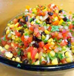 Summer salsa  1 small onion, finely chopped  1 garlic clove, finely chopped  1 lime, zest & juice  pinch of salt  drizzle of olive oil  4 roma tomatoes, chopped  1/4 orange bell pepper, chopped  1/4 red bell pepper, chopped  1/4 yellow bell pepper, chopped  1 jalapeno, seeded & diced  1 c. black beans  1 c. frozen corn  1/2 c. chopped cilantro
