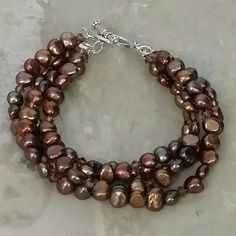 Check out this item in my Etsy shop https://www.etsy.com/listing/481860036/brown-4-strand-freshwater-and-swarovski