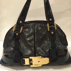 """Michael Kors Black Patent Leather Satchel This Michael Kors handbag is gorgeous. Gold hardware. Excellent condition. One minor scratch in the front. Very clean inside and outside. No dust. Authentic. Width 16"""". Height 10.5"""". No trade. Michael Kors Bags"""