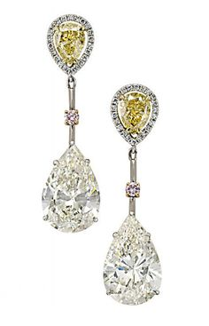 AN ATTRACTIVE PAIR OF DIAMOND AND COLOURED DIAMOND EAR PENDANTS   Each designed as a pear-shaped diamond weighing 7.20 and 7.09 carats to the knife-edge pink diamond spacer and pear-shaped Fancy Intense Yellow diamond surmount, 4.0 cm long