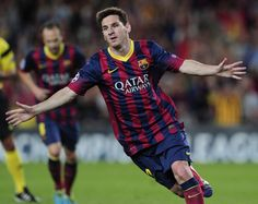 Barcelona's Argentinian forward Lionel Messi celebrates after scoring during the UEFA Champions league football match FC Barcelona vs Ajax Amsterdam at Camp Nou stadium in Barcelona on September 18, 2013