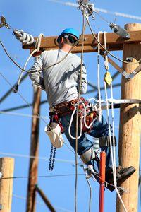an electrical lineman working on lines by Annette Shaff, via ShutterStock Lineman Love, Power Lineman, Electrical Lineman, Electrical Grid, Amarillo College, Journeyman Lineman, Trains, Construction Jobs, Working Man
