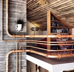 Industrial interior pipe rails - great how the pipes come from every direction