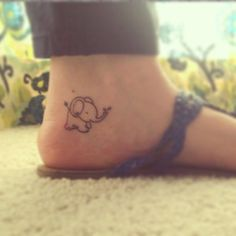 Cute Elephant Foot Tattoo. Like the Placement