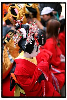 Close up of the oiran's child attendant, known as kamuro, and her amazing hairstyle and kanzashi-photo by hashiee, via Flickr