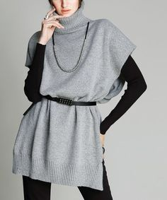 Stay warm while looking polished in this versatile layering piece that has a waist-enhancing belt and a cozy turtleneck. Size note: This item is from a European brand. Please refer to size chart.Shipping note: This item is shipping internationally. Allow extra time for its journey to you.