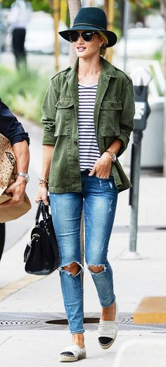 Rosie Huntington-Whiteley wears a striped t-shirt, army jacket, distressed jeans, and Chanel espadrilles