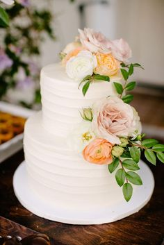 White wedding cake, blush and orange florals, two tier cake, follow this board for more wedding cake inspiration // John Schnack Photography