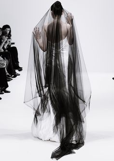 Long. Black. Veils. Great over a white wedding dress and adds just that touch of Halloween!
