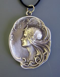 Art Nouveau Cameo Necklace Inspired by Alphonse Mucha. I have this somewhere in storage. Cameo Jewelry, Cameo Necklace, Antique Jewelry, Vintage Jewelry, Bijoux Art Nouveau, Art Nouveau Jewelry, Alphonse Mucha, Art Nouveau Design, Pewter