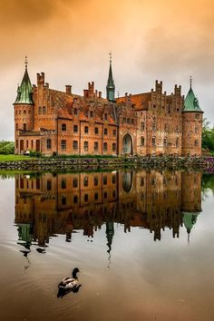 Egeskov Castle | A 450 yr. old castle in Egeskov in Southern Funen, Denmark. The castle is famous for being the most preserved moat castle in Europe, with it's some 2,000 windowpanes.