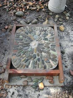 Jeffrey Bale's World of Gardens: Building a Pebble Mosaic Stepping Stone ... might be a bit time consuming, but SO beautiful!!! (this blog has a number of beautiful mosaic designs!)