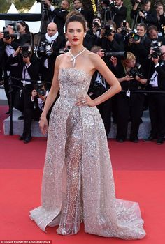 Shimmering: Alessandra Ambrosio certainly didn't disappoint in the fashion stakes as she attended The Last Face premiere at the 69th Film Festival at Cannes on Friday evening