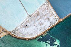 Photographer Simon Butterworth captured stunning aerial shots of these blue salt fields in Australia.