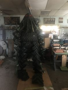 Outdoor yard art fashioned into a monster made from recycled tractor tires.