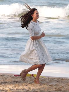 The Royals Celebrate Easter Down Under   EASY-BREEZY   It's like she's filming a shampoo commercial! Running in heels is no problem for Kate, who sprinted in the sand while visiting Manly Beach's lifeguards.