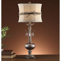 Add sophistication to any room in your home with this beautiful table lamp. Elegant/Traditional lighting appliance complements many decors.
