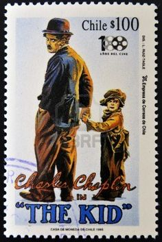 CHILE - CIRCA 1995: A stamp printed in Chile shows Charles Chaplin in The Kid, circa 1995 Stock Photo