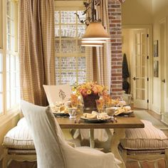 breakfast nook with lots of windows and natural light :) a wooden table with flowers