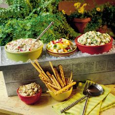 For your next outdoor party set up a salad bar by purchasing a decorative planter box and filling it with ice to keep your salads nice and chilled!