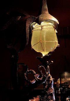Metal lamp with water vortex. Surindustrialle Gallery in Lodz / Poland. Scrap metal art, welding applied art and jewellery