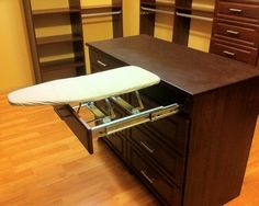 ✥ My husband would love this!  Island is Cyanne finish with Brown Leather Thermofoil top. Pull out ironing board in top drawer.