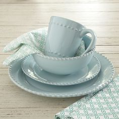 Milford 16-Piece Dinnerware Set, Pool | Crafted of embossed stoneware, this pool-colored dinner set includes four dinner plates, four salad plates, four bowls, and four mugs. Microwave and dishwasher-safe.