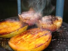MANGO FLAMBE - Halve mangoes on either side of the pit. Score the flesh but don't cut through the skin. Drizzle with melted butter and sprinkle with brown sugar. Place cut side down on the grill. Flip when carmelized and cook skinside. When fruit is hot, pour a teaspoon of 40% liquor over each mango half. Rum or Pear Brandy is excellent! Quickly light the alcohol and let it burn off. Serve as is or turn inside out. Spoon the pan drippings over the mangoes. Serve plain or with ice cream. Mango Recipes, Fish Recipes, Whole Food Recipes, Homemade Tacos, Homemade Taco Seasoning, Carmelized Pears, Flambe Recipe, Flambe Desserts, Pear Brandy
