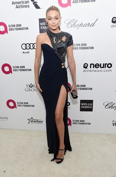 Gigi Hadid Evening Dress - Gigi Hadid was ultra modern, sexy, and glamorous in equal parts in an asymmetrical, high-slit gown by Atelier Versace during Elton John's Oscar-viewing party.