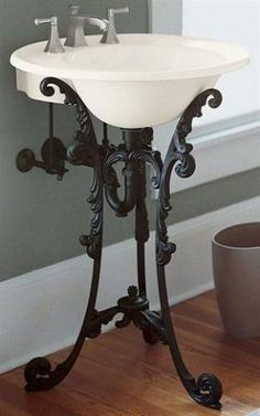 A black iron pedestal sink that brings the charm of ornate antique furniture. by letha