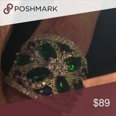 Gorgeous statement ring in SS This ring is so beautiful with white cubic zirconia, green cubics and blue cubics. This ring is about one inch wide. Jewelry Rings