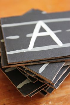 DIY Learning Letters Game: Spelling Names and driving cars along the built road.
