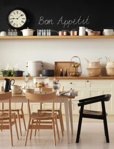 smart bistro-style kitchen-diner with ercol Holland Park chairs in clear.  inspiration idea: create temporary chalk board stripe across a wall using chalkboard contact paper