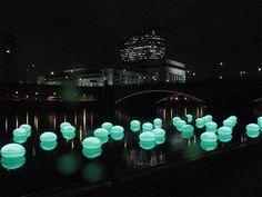Philadelphia.  Interactive lighting installation along the Schuylkill river. RFID-enabled Light Drift was designed by Howeler + Yoon Architecture and was made up of a series of orb seats, that when used by people to sit, triggered the orbs floating in the river, thus illuminating and creating a light pattern between the land and water.