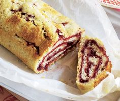a cut rolled pastry with suet and raspberry jam
