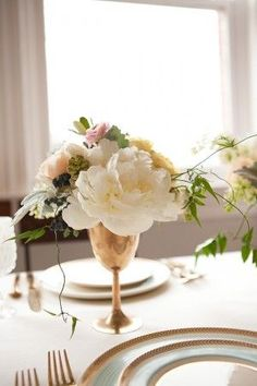 Gold goblet centerpiece with gorgeous flowers