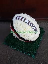 Image result for rugby ball flower arrangement