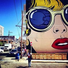 British artist D*Face and his team put his mark on Puerto Rico this week. While he is in town for Santurce es Ley 4, he decided to bless a wall on Calle Aurora San Juan, 00907. The mural is a colorful, Lichtenstein-like stencil of a woman's face. The blonde haired subject is wearing glasses with an odd visual in the reflection. He calls the mural 'Reflection Eternal' and it can clearly be seen from all points high in Puerto Rico. Cool Visual!