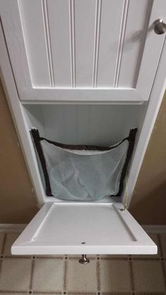 Between The Studs Built In Hamper Wonder If This Would Work For Trash Cans Decor
