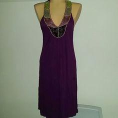 BCBGmaxazria purple beaded dress Purple dress with beaded vneck. 100% viscose. Size medium BCBGMaxAzria Dresses