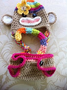 This listing is for an adorable super colors rainbow sock monkey hat and diaper cover with a bendable tail! There are so many bright colors included with this set such as hot pink, purple bright orange, lime, yellow, robbin egg blue, peach bright purple and brown. This set comes in