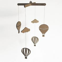 These natural wooden mobiles will compliment any childs room.