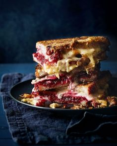 A comfort food favourite; this oozing toastie tower of wonder – made with cheese, ham and a homemade beetroot chutney – is snack time royalty. Serve it hot, straight from the oven, to appreciate all its cheesy goodness. Ham And Cheese Toastie, Cheese Toasties, Toast Sandwich, Sandwich Board, Good Food, Yummy Food, Menu, Cafe Food, Beetroot
