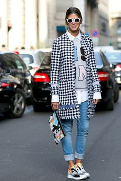 Milan Fashion Week Fall 2015 - tweed black and white check coat, graphic sweatshirt over a white button-down shirt + cuffed skinny jeans and sneakers