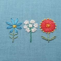 """Ribbon Embroidery I'm stitching up an old favorite of mine in preparation for the opening of my Etsy shop. A wildflower trio, from left to right: aster, Queen Anne's lace, and firewheel. And isn't """"firewheel"""" the perfect name for that little flower? Embroidery Neck Designs, Embroidery Flowers Pattern, Simple Embroidery, Hand Embroidery Stitches, Silk Ribbon Embroidery, Floral Embroidery, Cross Stitch Embroidery, Bordado Floral, Brazilian Embroidery"""